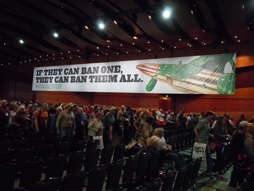 A crowd of NRA members and guests crowded into the Grand Ballroom of Nashville's Music City Center to hear from GOP Presidential hopefuls under a banner referencing green tip ammunition. (Photo: Chris Eger/Guns.com)