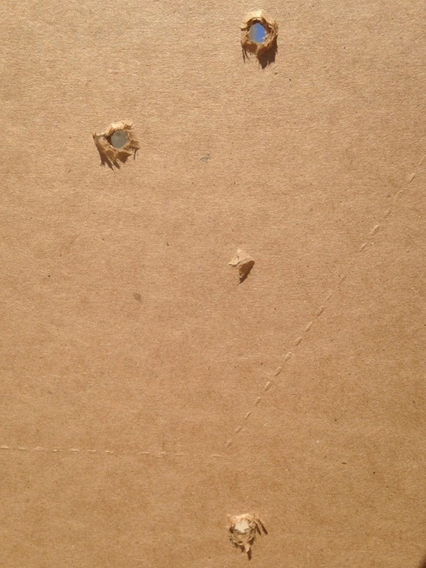 frangible round 5 rounds at 5 yards, on cardboard target. through plywood.