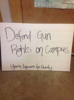 Nicole Sanders sign defend gun rights on campus