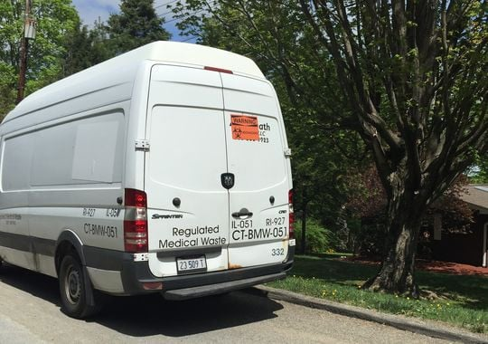 A medical waste van was parked outside the woman's home Saturday afternoon, presumably for cleanup from the morning's incident. (Photo: The Journal News)