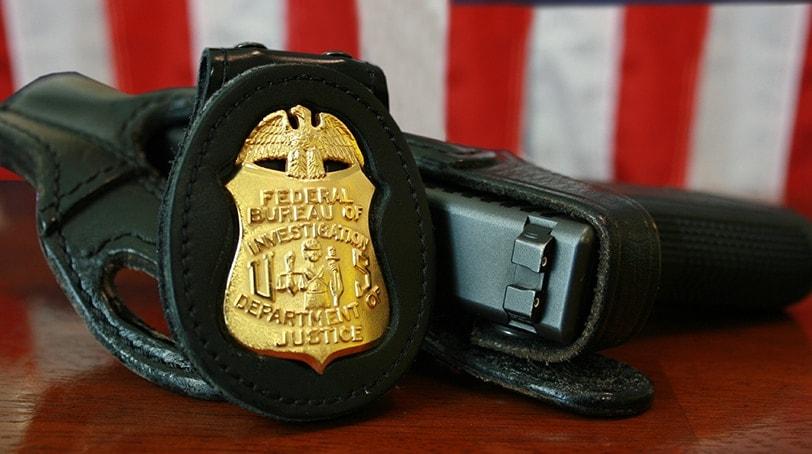 FBI badge and service pistol, a Glock Model 22, .40 S&W caliber (Photo: Federal Bureau of Investigation)