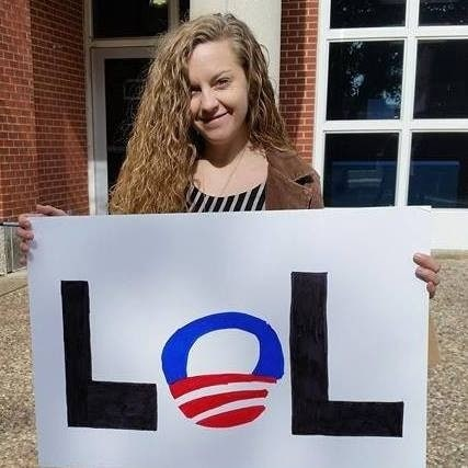"""Nicole Sanders holds a sign reading """"LOL,"""" with the """"O"""" drawn to look like President Barack Obama's campaign logo. (Photo: Nicole Sanders)"""