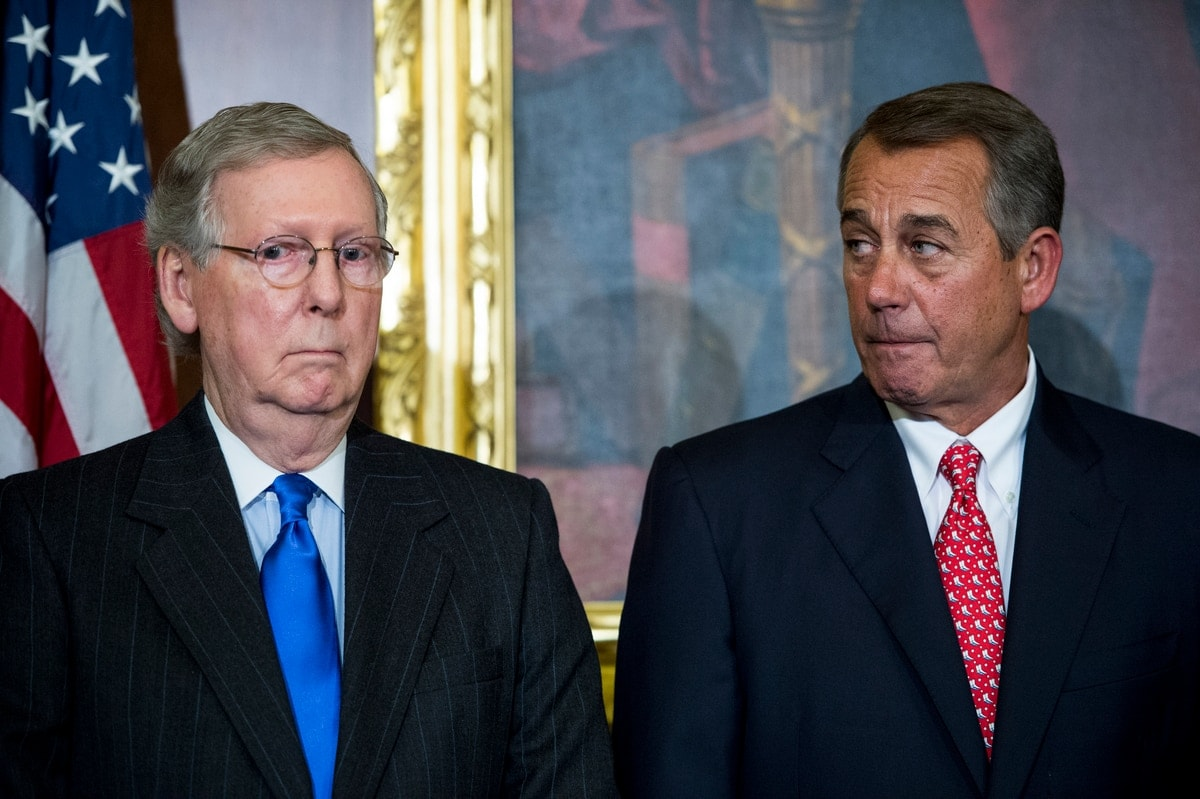 "UNITED STATES - FEBRUARY 10: Senate Majority Leader Mitch McConnell, R-Ky., left, and Speaker of the House John Boehner, R-Ohio, participate in the ceremony to sign H.R.203, the ""Clay Hunt Suicide Prevention for American Veterans Act."" in the Capitol on Tuesday, Feb. 10, 2015. (Photo By Bill Clark/CQ Roll Call)"