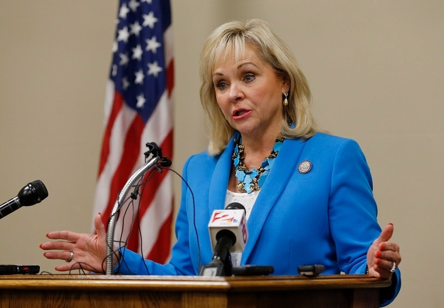 Gov. Mary Fallin (R) has rejected a pro-gun measure that would have ensured carry rights on public areas rented for private use. (Photo: AP/Sue Ogrocki)