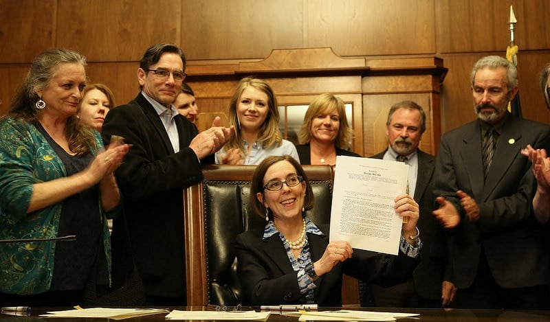 Gov. Kate Brown signed controversial SB 941 Monday, mandating Brady-style background checks on most gun sales and transfers in Oregon. (Photo: Oregon Governor's office)