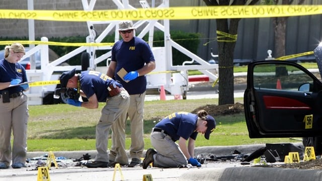 With a massive crime scene, investigators spent hours pouring over every bit of evidence. (Photo: Getty)