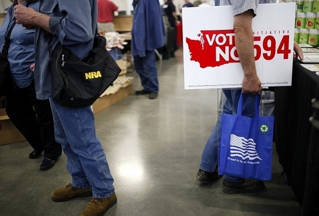 As backers of the state's new background check argue they have won, a gun show in Washington that does not agree is set for this weekend. (Photo: Ian Terry/The Herald)