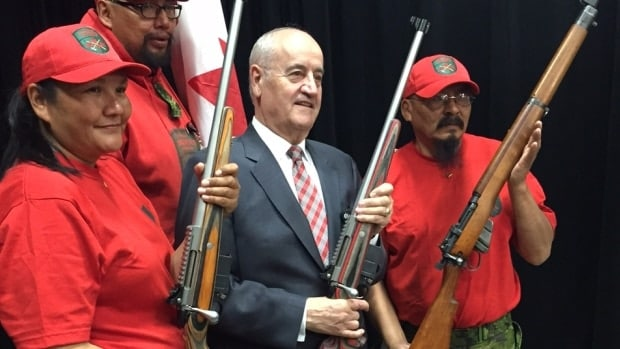 Canadian Associate Minister of Defence Julian Fantino and Canadian Rangers at the Colt Canada plant with the new prototype Sako TC3s. (Photo: CBC/Albert Delitala)