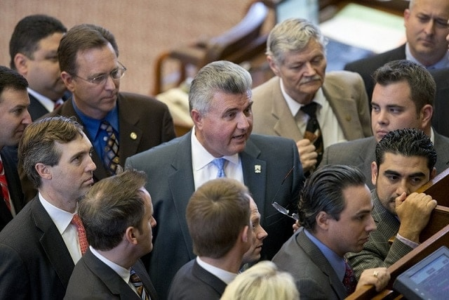 Texas State Rep. Allen Fletcher, R-Tomball, center, helped shepherd a watered down campus carry bill through the House this weekend. (Photo: Bob Daemrmich/Texas Tribune)