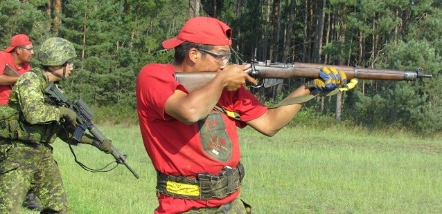 Canadian Ranger Leo McKay firing with a Lee-Enfield rifle at Canadian Forces Base Borden in 2012.  These dated Enfields are finally being put to pasture. (Photo: Torstar News Service)