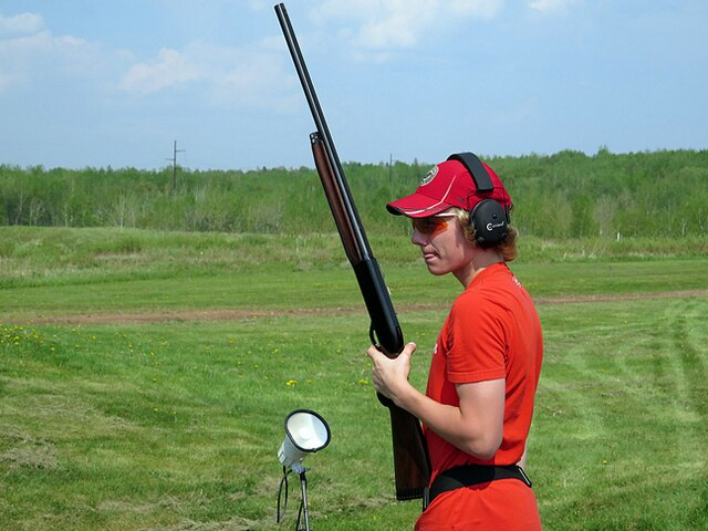 Middle school student Kohlton Miller patiently waits his turn to have a go at some clay pigeons. (Photo: Minnesota Public Radio)
