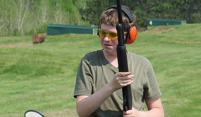 Collin O'Toole is disappointed that he missed a clay pigeon. (Photo: Minnesota Public Radio)