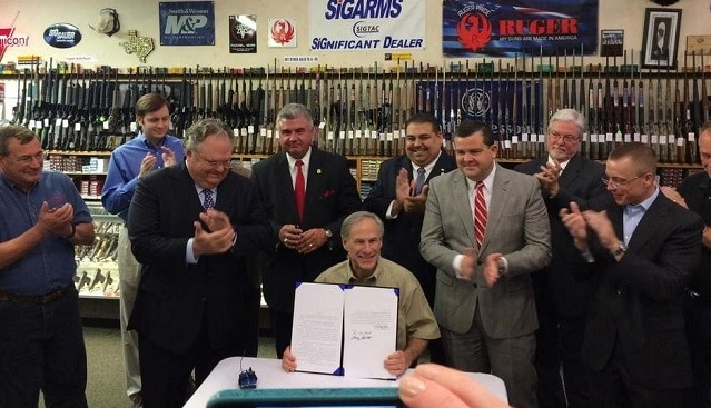 Texas Gov. Greg Abbott (R) signed two contentious gun rights reform bills into law Saturday afternoon. (Photo: KBTX)