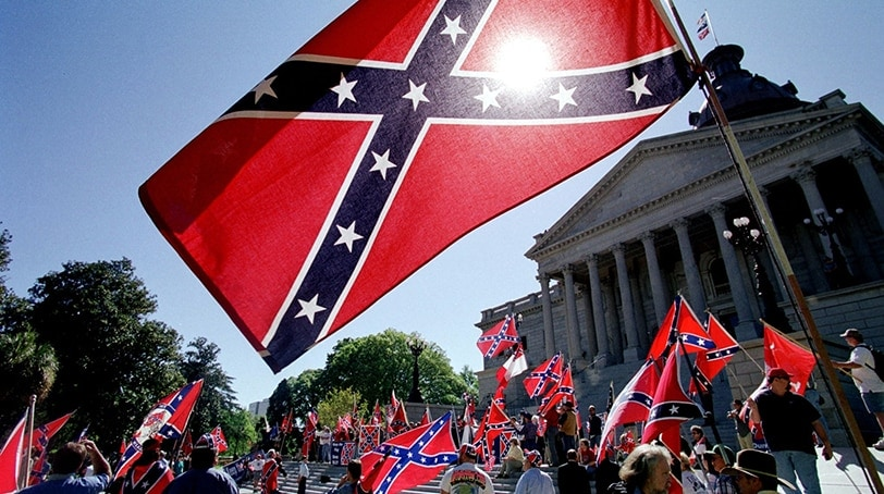 Confederate flag supporters demonstrate on the north steps of the capitol building in April 2000 in Columbia, SC.  (Photo: Erik Perel, AFP/Getty Images)