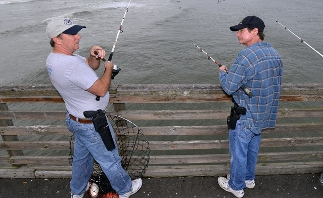 Sunshine State anglers are allowed to open carry while fishing as seen in the above on a Jacksonville pier. (Photo: Jacksonville.com)