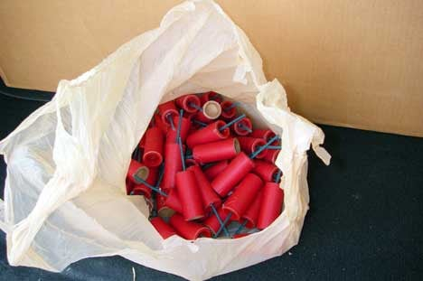 The collection of unlabeled firecrackers inside a grocery bag is a good indicator that they're homemade.