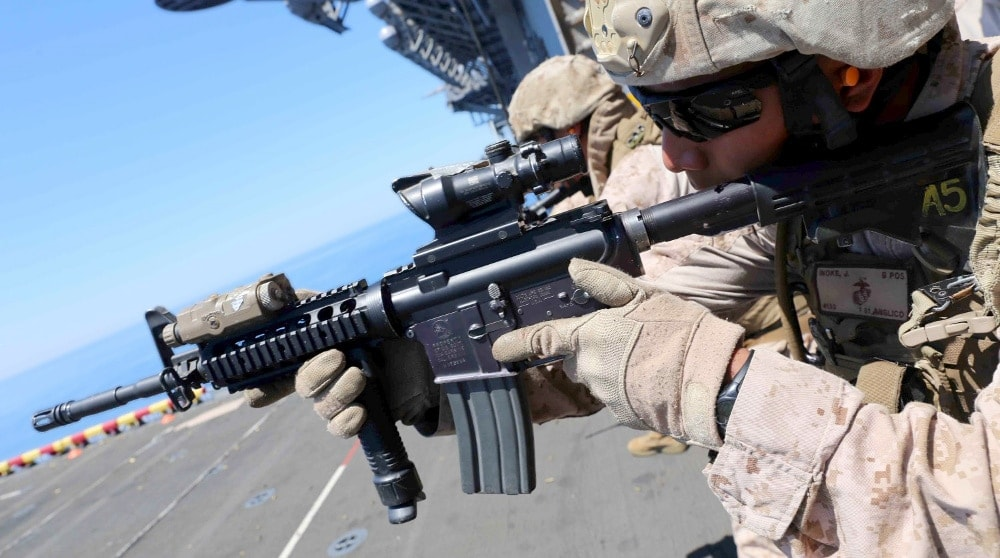 Lance Cpl. Jodie Inoke, a radio operator with 1st Air Naval Gunfire Liaison Company (ANGLICO), fires his M4 carbine as part of close quarter tactics (CQT) training during Composite Training Unit Exercise (COMPTUEX) off the coast of southern California, May 15, 2014. COMPTUEX is the second at-sea period during the 11th MEU's predeployment cycle, in which the MEU will conduct concurrent mission planning and execution integrated across all element of the Marine Air Ground Task Force while supporting Amphibious Squadron 5 in their evaluated training. (U.S. Marine Corps photo by Cpl. Demetrius Morgan/Released)