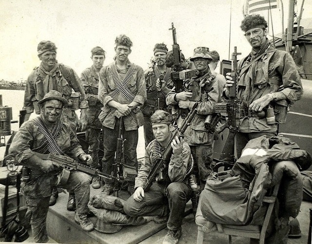 Navy SEALs rocking a couple Stoners somewhere in Southeast Asia. (Photo: specialoperations.com)