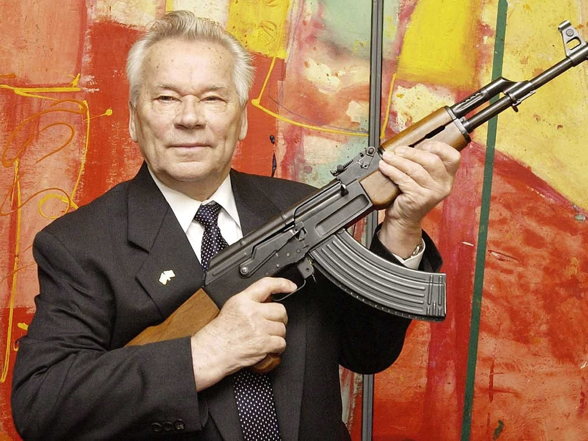 "Russian weapon designer Mikhail Kalashnikov presents his legendary assault rifle to the media while opening the exhibition ""Kalashnikov - legend and curse of a weapon"" at a weapons museum in eastern Germany in 2002."