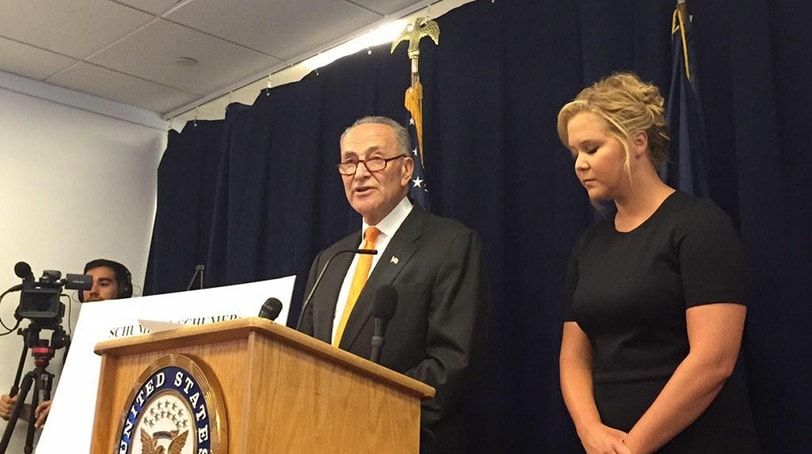 Actress Amy Schumer and New York Sen. Charles Schumer unveil legislation aimed at a NICS fix, calling on states to submit more mental health records. (Photo: Everytown)
