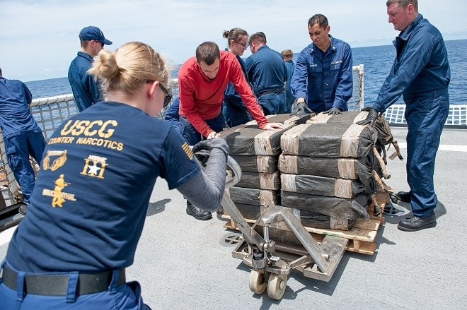 Coast Guard Cutter Stratton crewmembers secure cocaine bales from a self-propelled semi-submersible interdicted in international waters off the coast of Central America, July 19, 2015. The Coast Guard recovered more than 6 tons of cocaine from the 40-foot vessel. (Coast Guard photo courtesy of Petty Officer 2nd Class LaNola Stone)