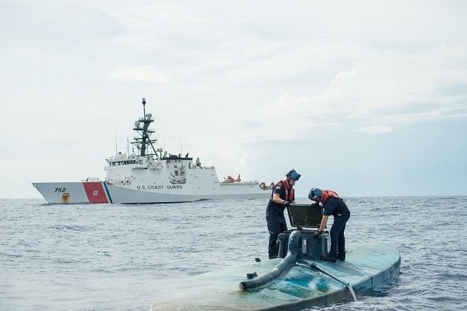 A Coast Guard Cutter Stratton boarding team opens the bridge of a self-propelled semi-submersible interdicted in international waters off the coast of Central America, July 19, 2015. The Stratton's crew recovered more than 6 tons of cocaine from the 40-foot vessel. (Coast Guard photo courtesy of Petty Officer 2nd Class LaNola Stone)