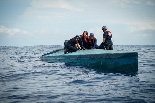 A Coast Guard Cutter Stratton boarding team member inspects the bridge of a self-propelled semi-submersible interdicted in international waters off the coast of Central America, July 19, 2015. The Stratton's crew recovered more than six tons of cocaine from the 40-foot vessel. (Coast Guard photo courtesy of Petty Officer 2nd Class LaNola Stone)