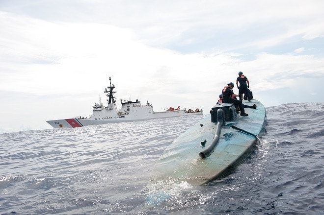 A Coast Guard Cutter Stratton boarding team investigates a self-propelled semi-submersible interdicted in international waters off the coast of Central America, July 19, 2015. The Stratton's crew recovered more than 6 tons of cocaine from the 40-foot vessel. (Coast Guard photo courtesy of Petty Officer 2nd Class LaNola Stone)