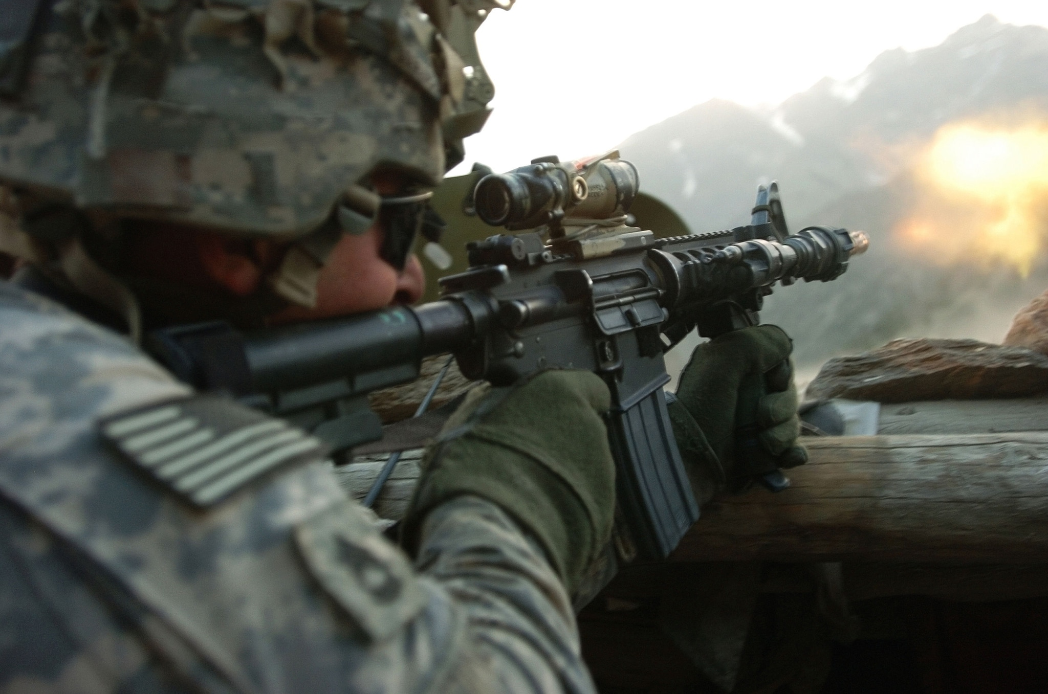 A U.S. Army soldier with 1st Battalion, 32nd Infantry Regiment, 10th Mountain Division, fires his weapon during a gun battle with insurgent forces in Barge Matal, during Operation Mountain Fire on July 12, 2009. The tiny mountain village, in Afghanistan's eastern Nuristan province, was overwhelmed by insurgents until combined elements of the Afghan National Security Forces and International Security Assistance Forces quickly forced the insurgents to flee. (Photo by U.S. Army Sgt. Matthew C. Moeller, 5th Mobile Public Affairs Detachment)