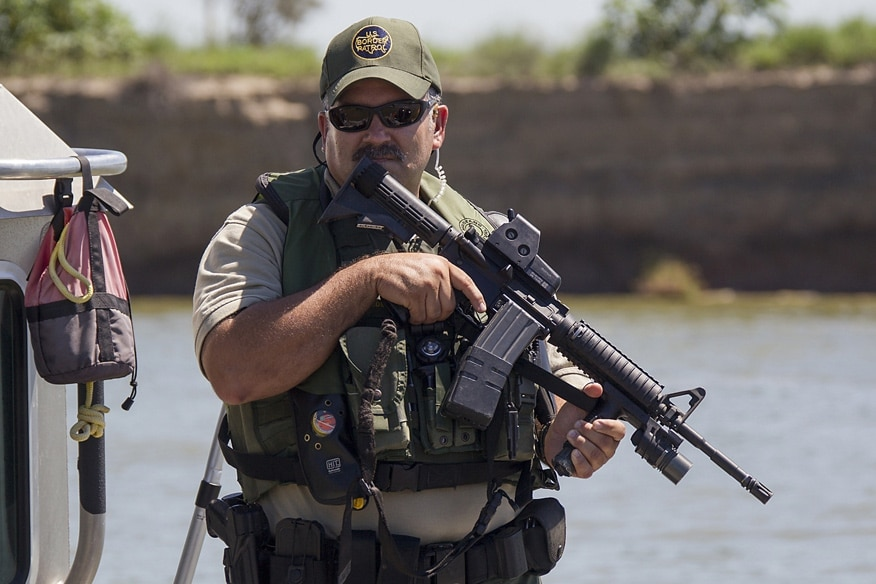 A Border Patrol Riverine agent conducts patrols in an Air and Marine Safe-Boat in South Texas, McAllen, along the Rio Grande Valley river on September 24, 2013.
