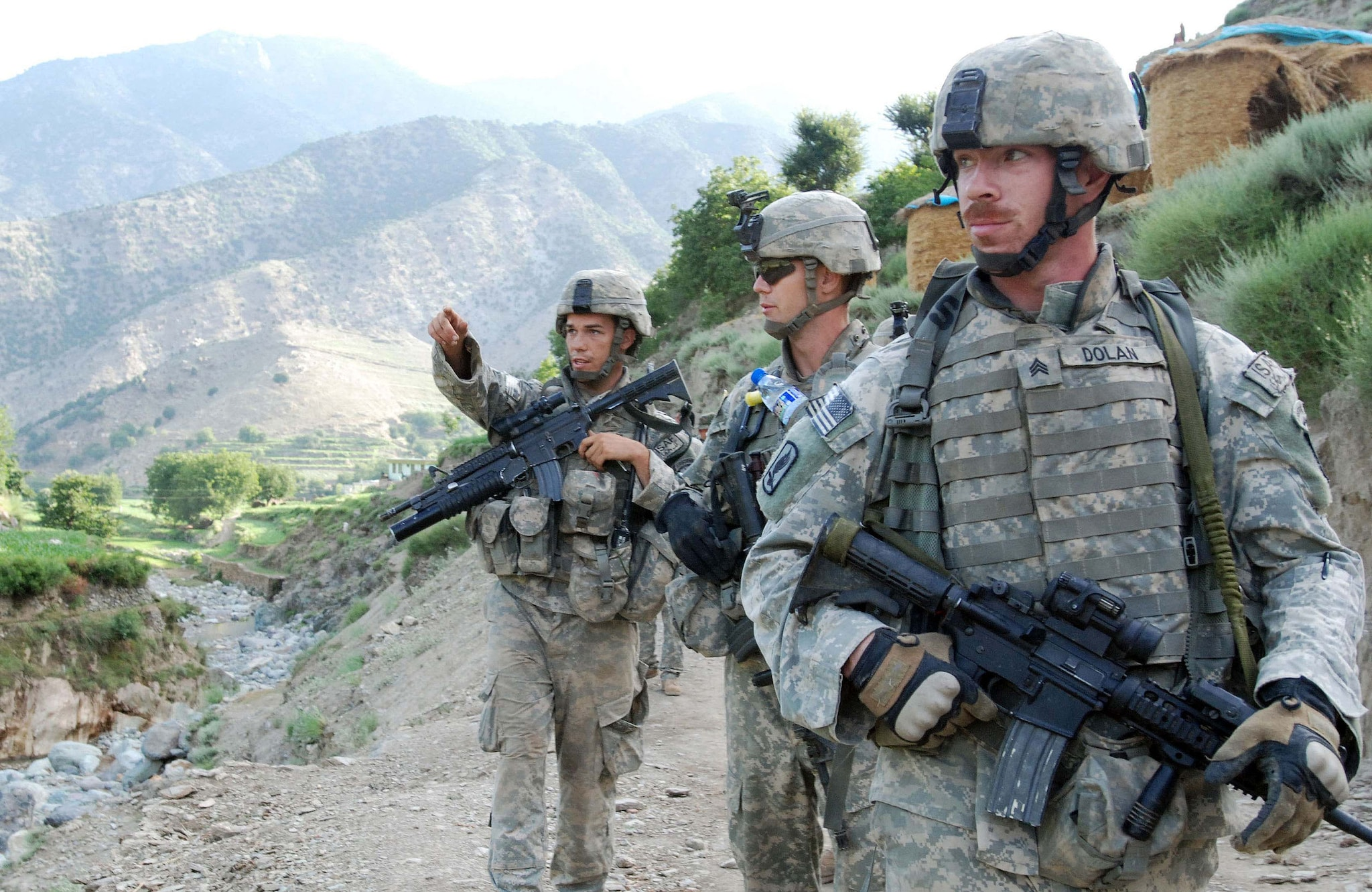 U.S. Army paratroopers from Red Platoon, Charlie Troop, 1st Squadron, 91st Cavalry Regiment (Airborne) navigate to Observation Post Chuck Norris in Dangam, Afghanistan on July 25, 2007, in Dangam, Afghanistan.