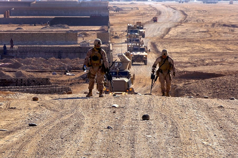 U.S. Marines use metal detectors to sweep a hill during a route reconnaissance mission of Route Red, which extends from Highway 1 to Shir Ghazay, Afghanistan, on Jan. 1, 2012. The Marines are assigned to the 2nd Platoon, Alpha Company, 9th Engineer Support Battalion, 2nd Marine Logistics Group. The purpose of the mission was to document inclines and declines in the route, sharpness of curves, the shortest width during the route, and where culverts were located or needed to be placed. (Photo: Department of Defense)