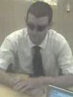 Authorities think he bought that shirt from Express. (Photo: FBI)