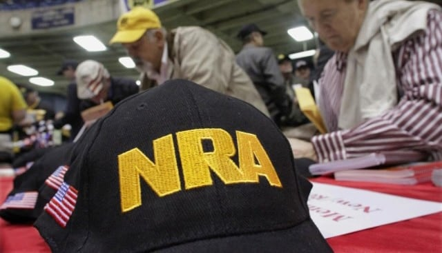National Rifle Association hats at a public event.
