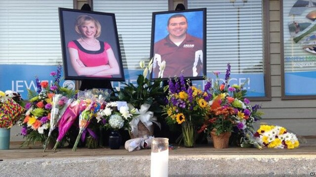 A memorial has popped up in front of the plaza where the shooting occurred. (Photo: Associated Press)