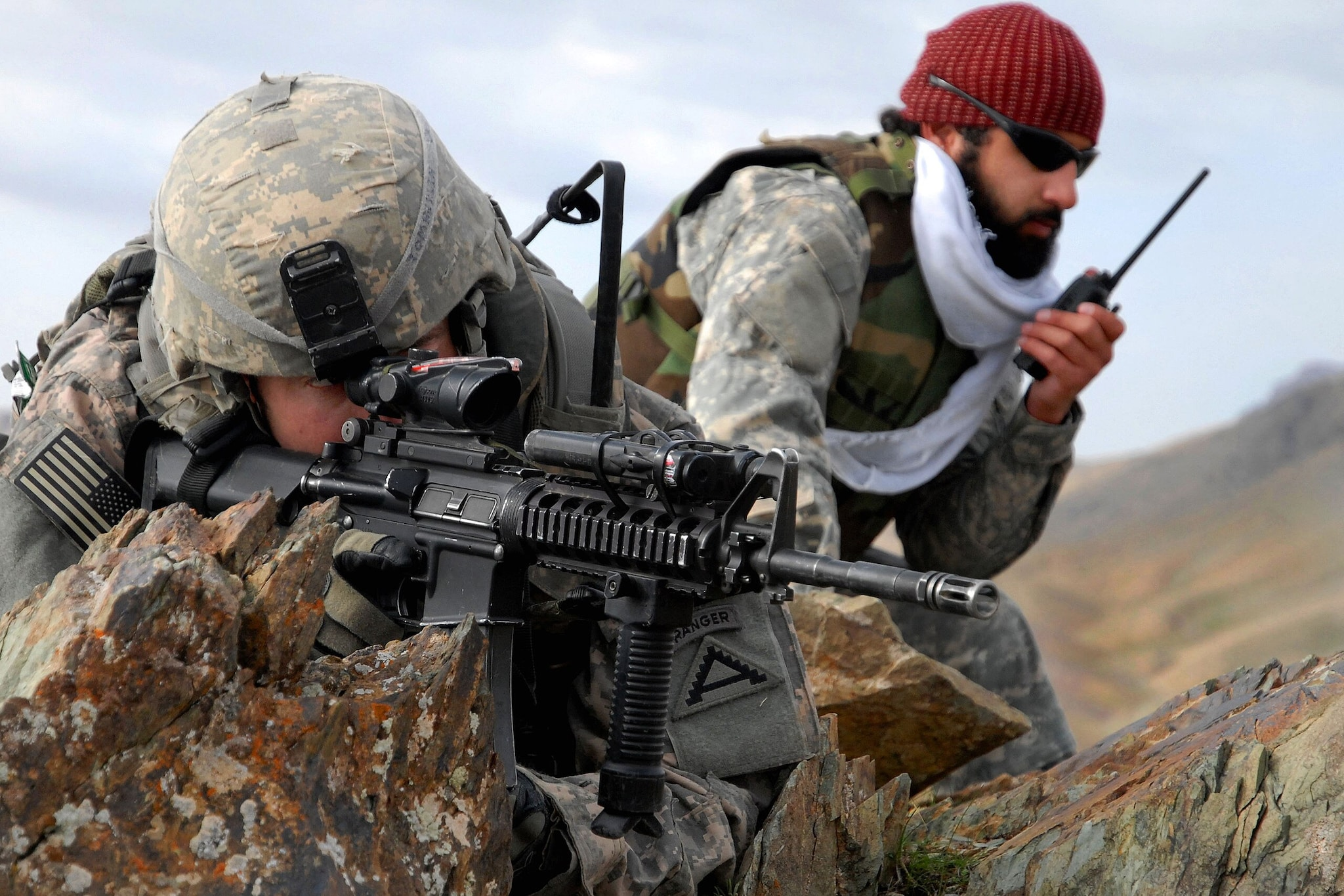 U.S. Army 1st Lt. Jared Tomberlin, left, and an interpreter pull security on top of a mountain ridge during a reconnaissance mission near Forward Operating Base Lane in the Zabul province of Afghanistan Feb. 28, 2009. Tomberlin is assigned to Bravo Company, 1st Battalion, 4th Infantry Regiment. (Photo: department of Defense)