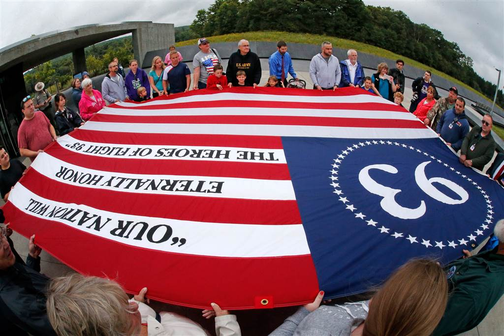 Visitors to the Flight 93 National Memorial in Shanksville, Pa., participate in a memorial service on Sept. 10. (Photo: Associated Press)