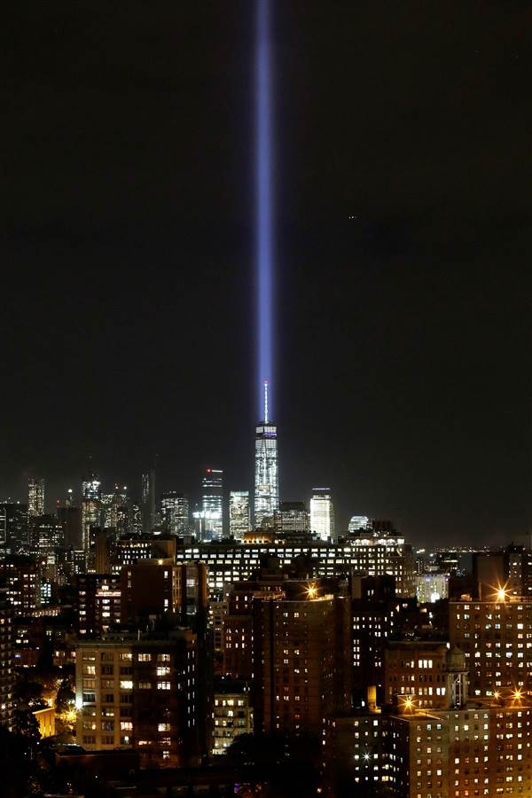 The Tribute in Light illuminates the sky behind One World Trade Center and the lower Manhattan skyline on Sept. 9. (Photo: Associated Press)