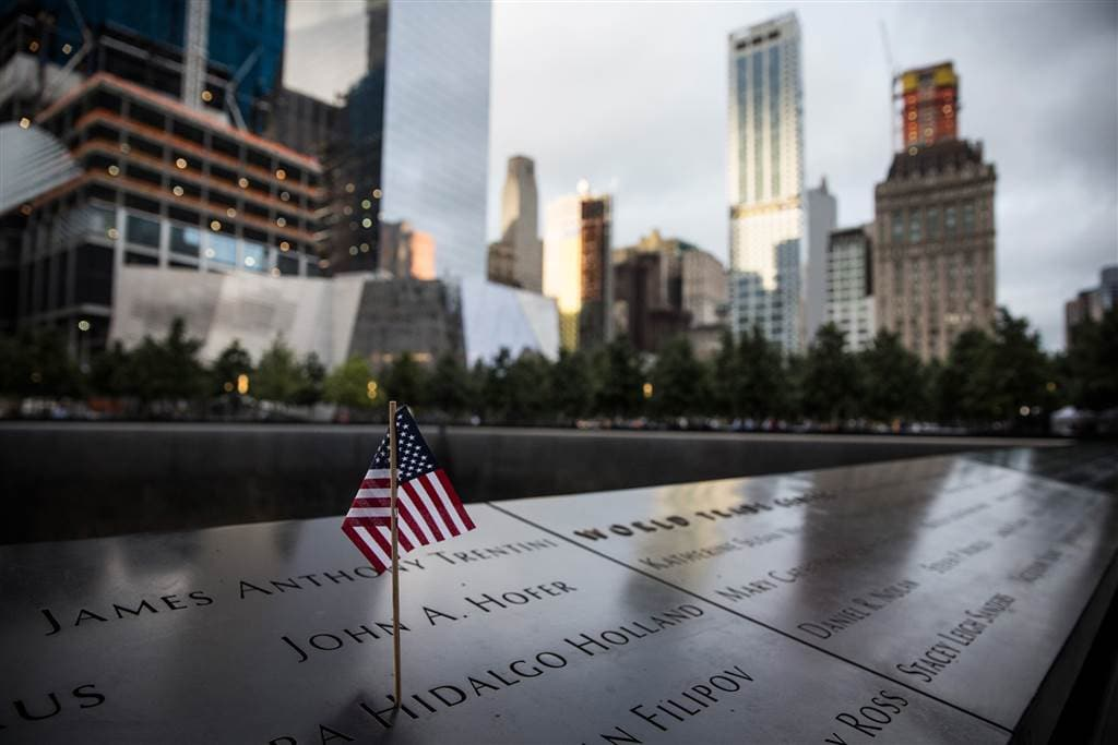 A tiny American flag stands on the memorial in New York. (Photo Getty Images)