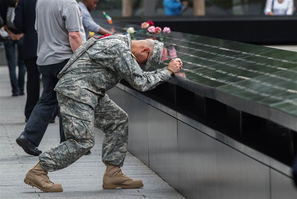 Army Sgt. Edwin Morales prays during the ceremony at the World Trade Center site. (Photo: Associated Press)