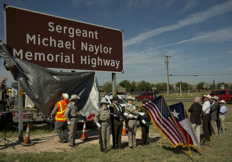 Midland Texans watch as a new marker memorializing Sgt. Michael Naylor in unveiled on Highway 191 just west of Loop 250 Thursday (Photo: Tim Fischer\Reporter-Telegram)