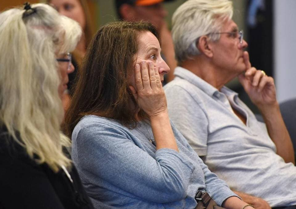 Summerville parent Laureen Campana-Schermeister, middle, listens to Tuolumne County Sheriff Jim Mele announce the arrest four teenage boys in school shooting plot during a press conference in Sonora, Calif., on Saturday, October, 3, 2015. (Photo: Modesto Bee)