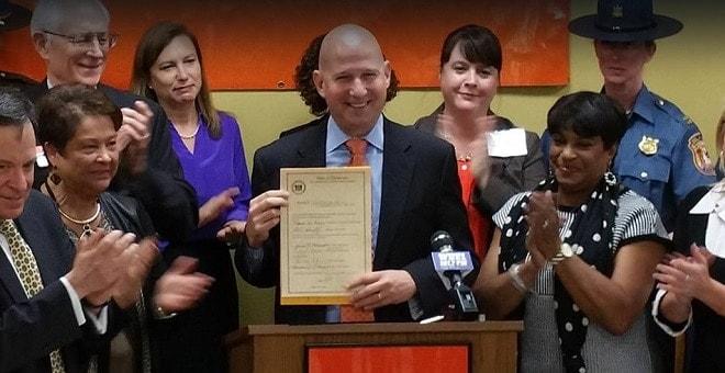 Deleware Markell signs domestic violence gun bill