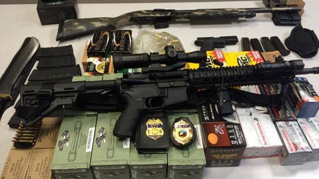 The guns and ammo recovered at the scene.