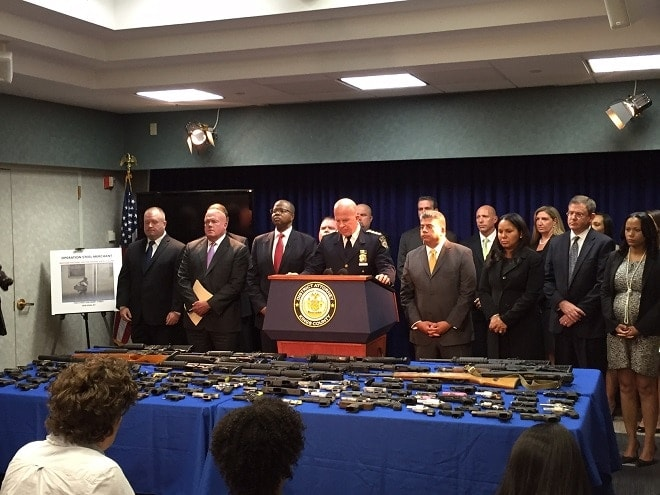 New York police charge 8 in Brooklyn gun running ring