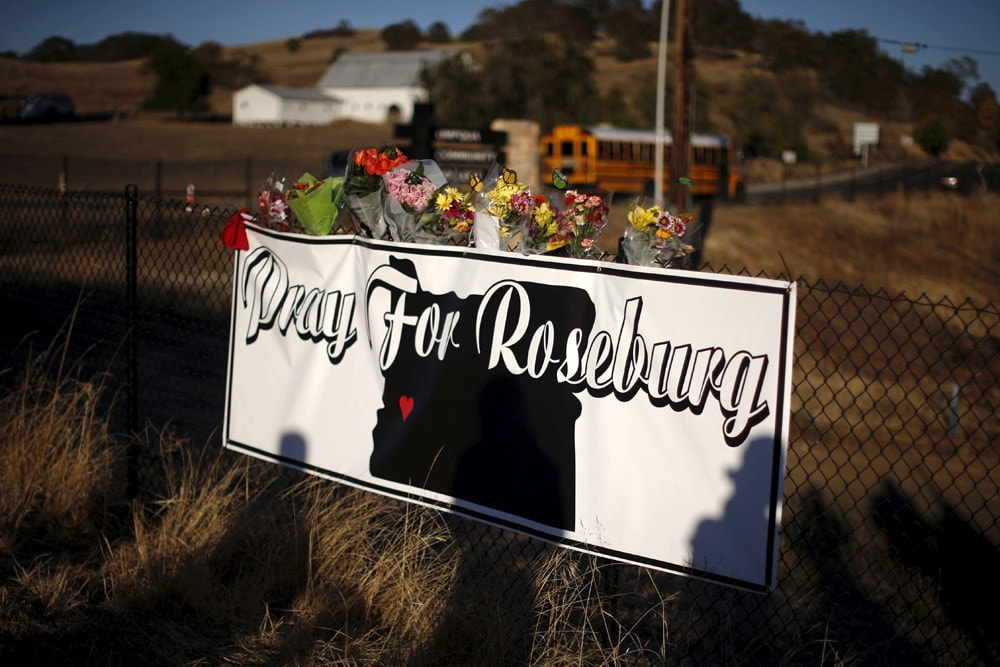 Memorial flowers are seen outside Umpqua Community College in Roseburg, Oregon, United States, October 2, 2015. Lucy Nicholson/Reuters