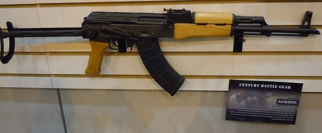...and the AK63DS under folder with Hungarian surplus parts in a new receiver and classic blonde furniture. The 16.25-inch barrel features a slant-cut muzzle brake.