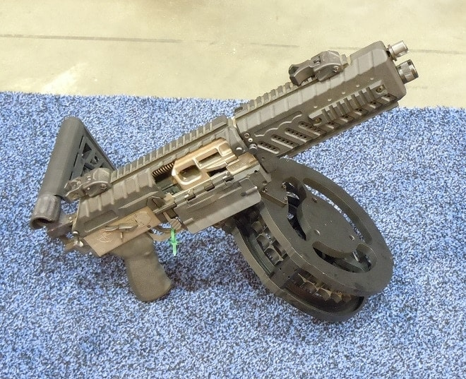 Complete with folding stock and 50-round drum mag