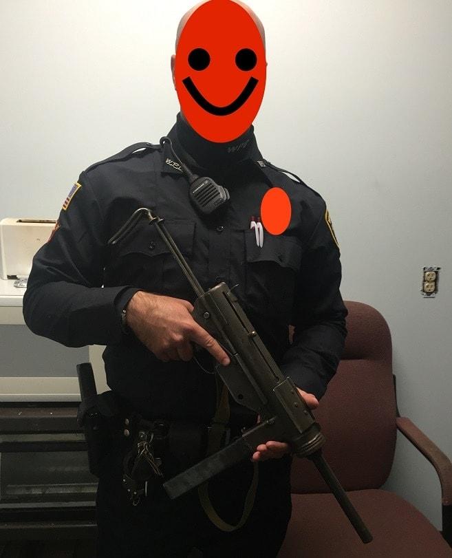 officer holding m3 grease gun
