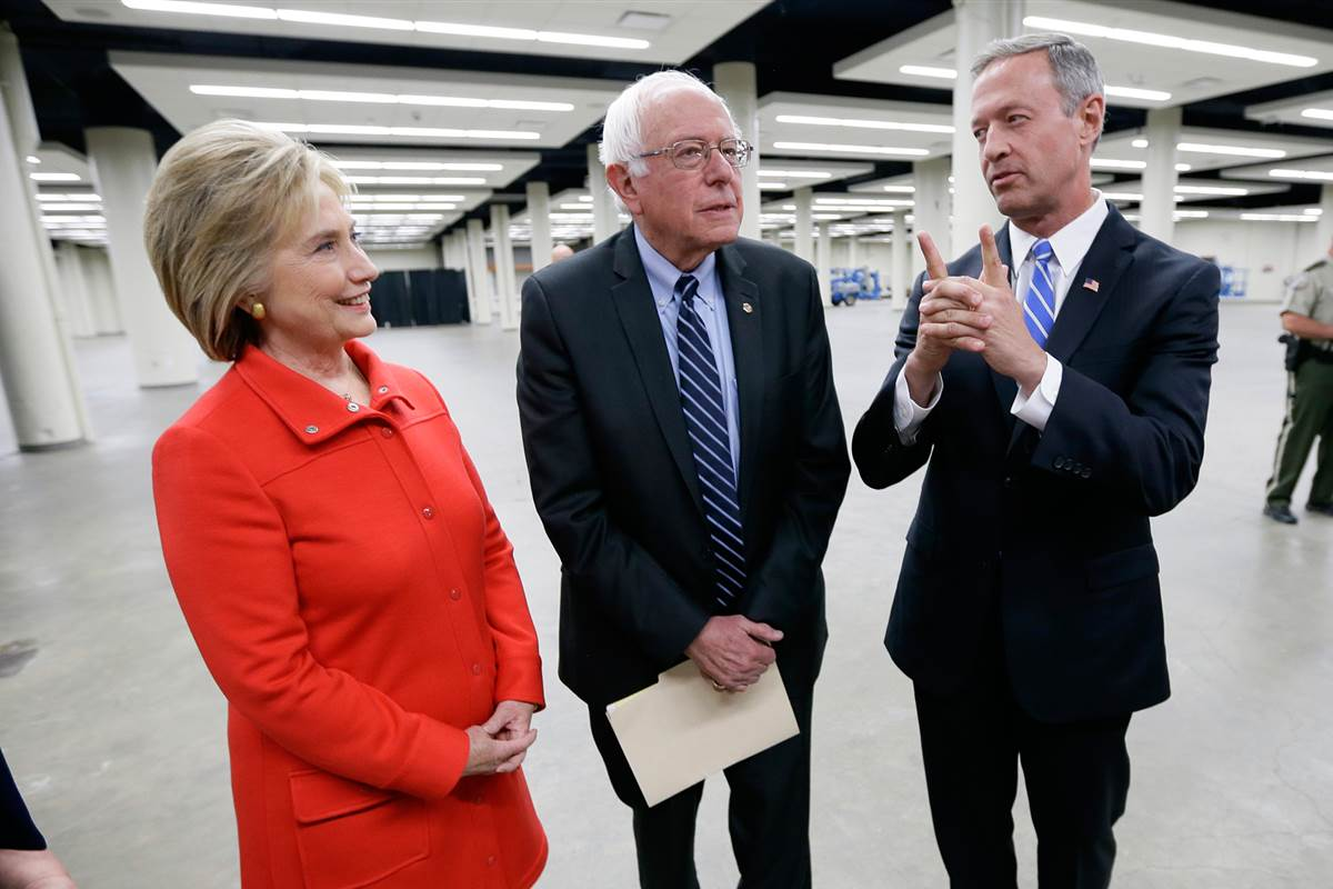 Hillary Clinton, Bernie Sanders and Martin O'Malley, talk backstage before the start of the Jefferson-Jackson Dinner. (Charlie Neibergall, AP)